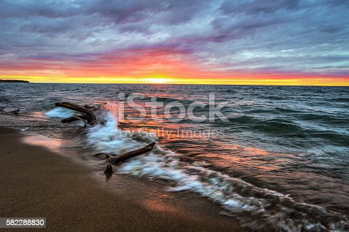 istock Lake Huron Driftwood On Sunset Beach In Paradise 582288830