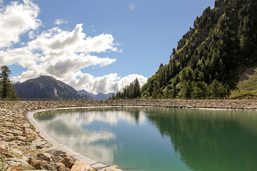 Lake in the high mountains near an alpine chalet