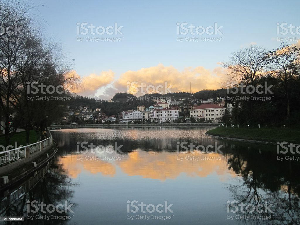 Lake in town stock photo