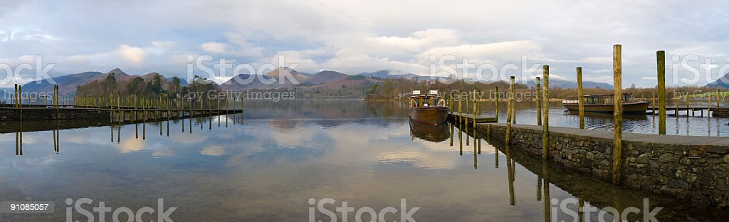 Lake, jettys, mountains, boats royalty-free stock photo