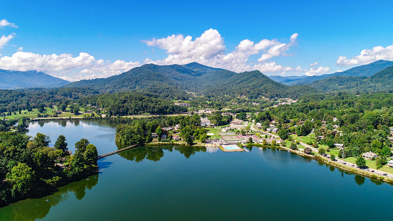 Drone Aerial of Lake Junaluska near Waynesville and Maggie Valley North Carolina NC during Autumn Fall.