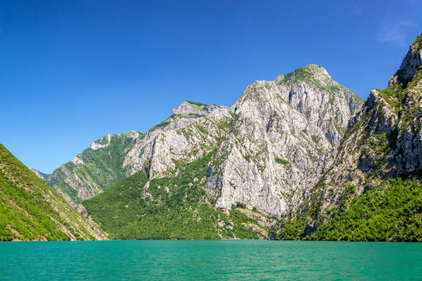 Lake Koman and the Albanian Alps stock photo