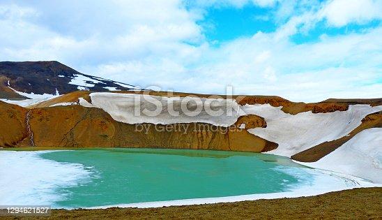 istock lake Krafla in volcaniccrater Iceland, unique landscape. 1294621527