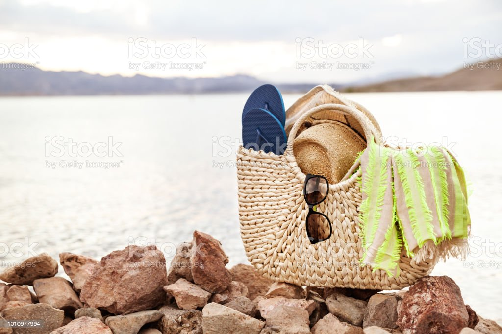 Lake Landscape And Summer Accessories On The Shore stock photo