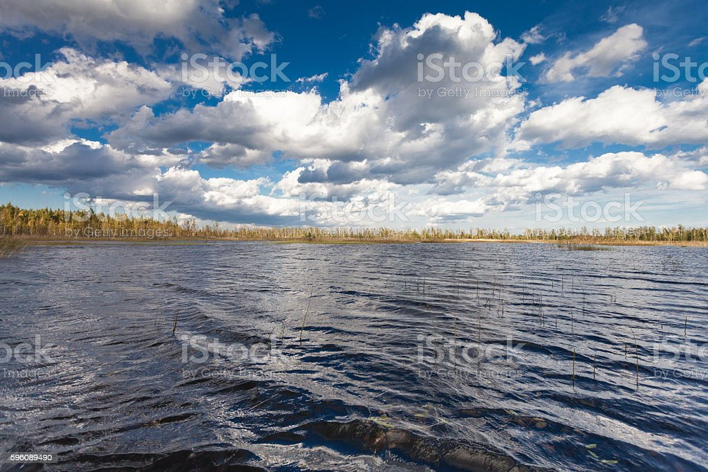 Lake landscape in autumn and blue sky with clouds royalty-free stock photo