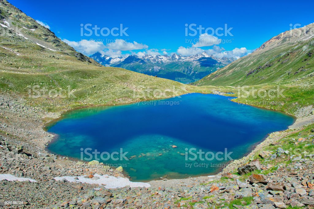 Lake Languard small alpine lake in the Rhaetian Alps in the Engadine valley stock photo