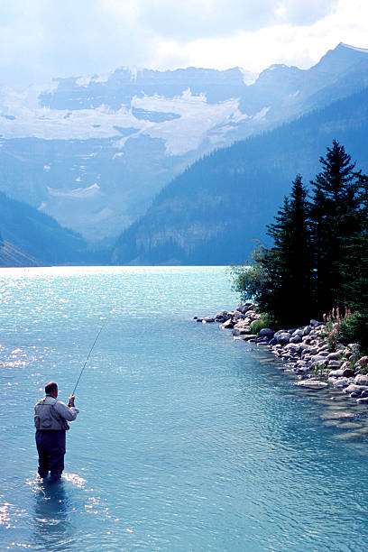 Lake Louise Fly Fisher stock photo