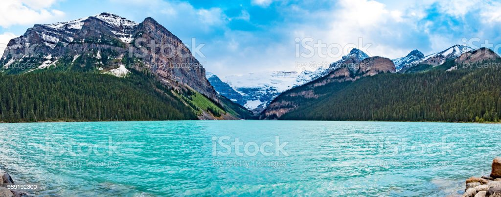 Lake louise panorama almost in the lake water stock photo