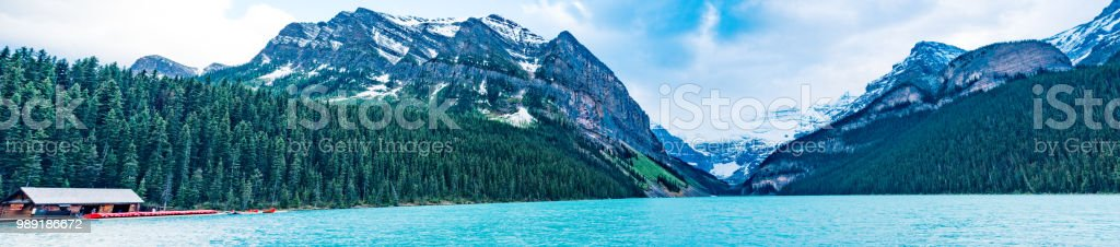 lake louise panorama with boat house and mountains stock photo