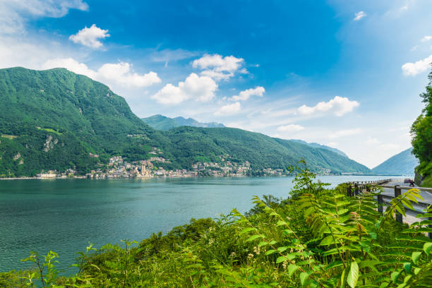 Lake Lugano, Campione d'Italia, Italy. View of the small town of Campione d'Italia, famous for its casino, and Lake Lugano, on a beautiful summer day stock photo