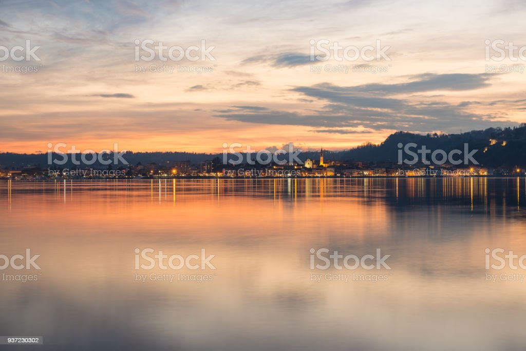 Lake Maggiore, colorful sky at sunset, northern Italy. Enchanting view, from Angera, of the city of Arona at sunset, province of Novara stock photo
