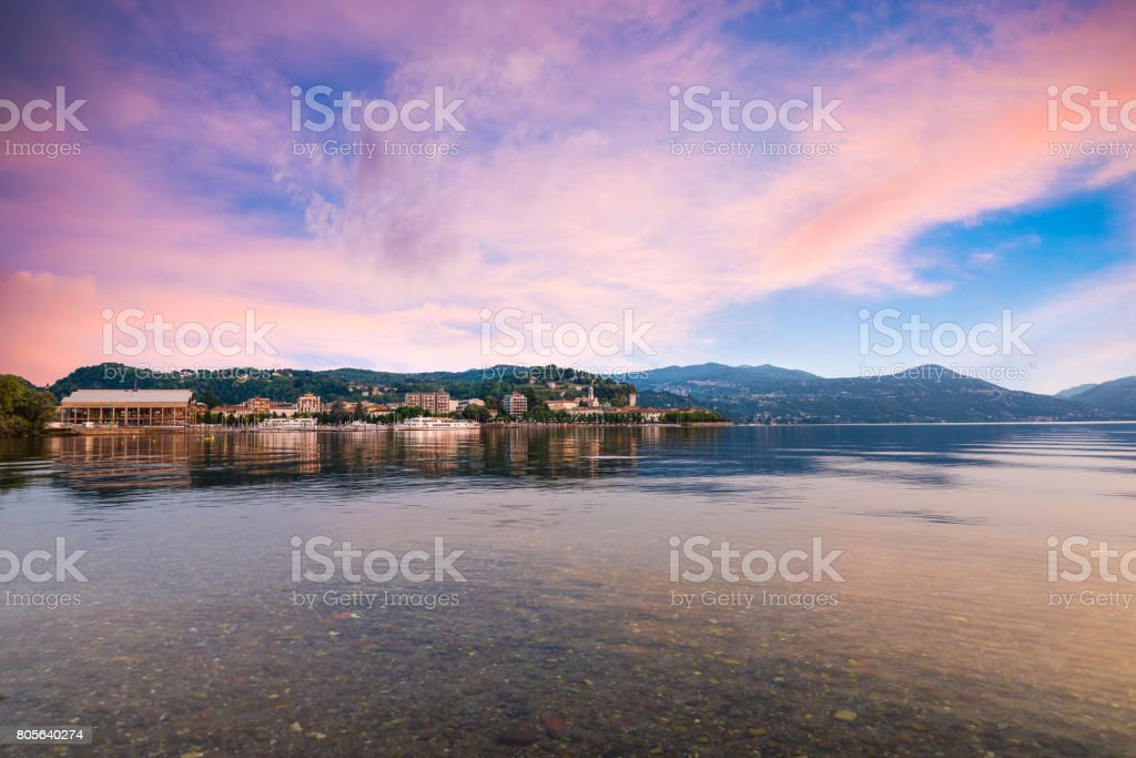 Lake Maggiore, colorful sky, northern Italy. Enchanting view of the city of Arona, province of Novara stock photo