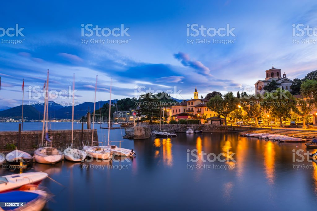 Lake Maggiore, Laveno, north Italy. View at sunrise of the beautiful small and old harbor and of the lakeside promenade of Laveno, province of Varese stock photo