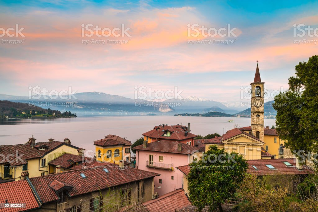 Lake Maggiore, Laveno, northern Italy. Picturesque sunrise over the lake Maggiore. Landscape toward the Piedmont shore between Stresa and Pallanza. stock photo