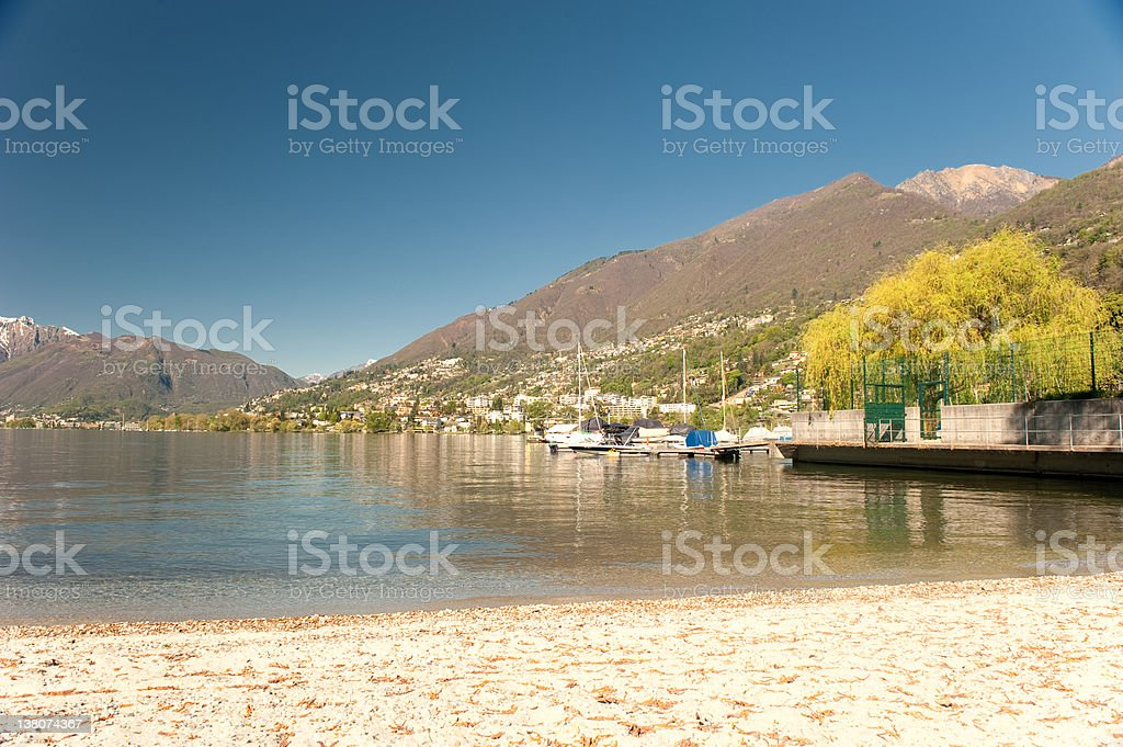 Lake Maggiore with boats and the city royalty-free stock photo