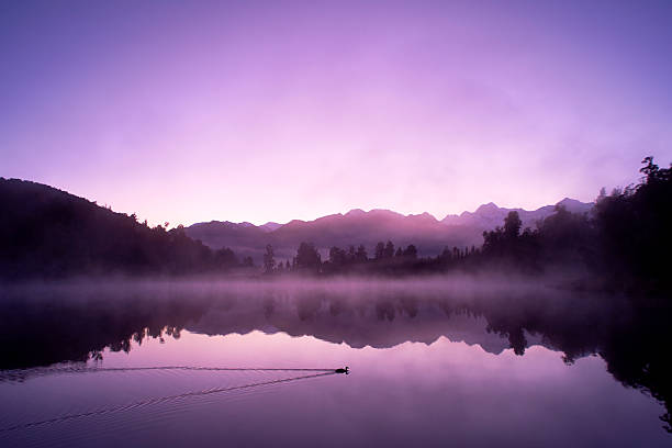 Lake Matheson And The Southern Alps At Dawn stock photo