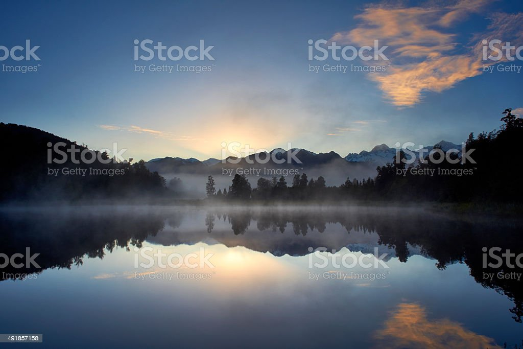 Lake Matheson And The Southern Alps New Zealand stock photo