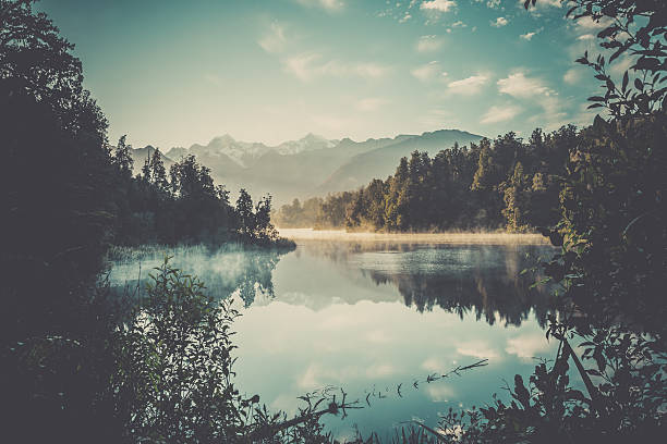 Lake Matheson Nature Panorama at Sunrise, New Zealand bildbanksfoto
