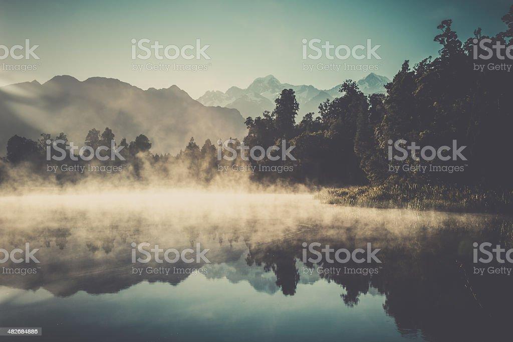Lake Matheson Nature Panorama at Sunrise, New Zealand stock photo