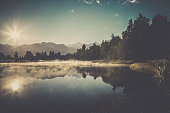 istock Lake Matheson Nature Panorama at Sunrise, New Zealand 624911160