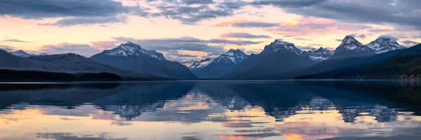 lake mcdonald in glacier national park at sunset - rocky mountains stock photos and pictures