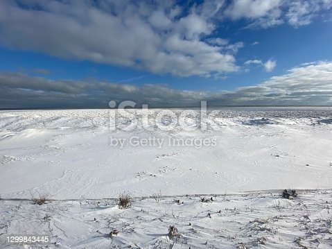 istock Lake Michigan shoreline covered in snow and ice 1299843445