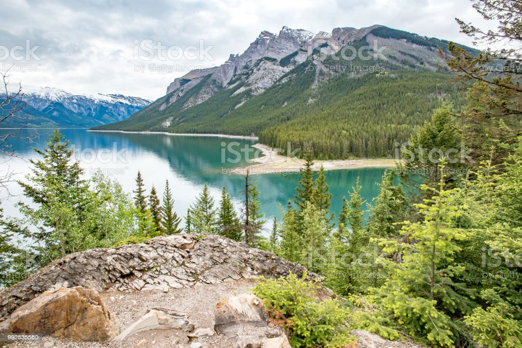 Lake Minnewanka view from high showing emerald lake and mountains in the background stock photo