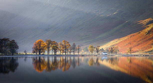 Lake mirror reflection Early morning shot of Buttermere in the Lake District.  english lake district stock pictures, royalty-free photos & images