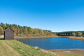 """istock Lake """"Mittlerer Pfauenteich"""" in the Harz mountains, Germany, with low water level because of a dry summer 1062141968"""