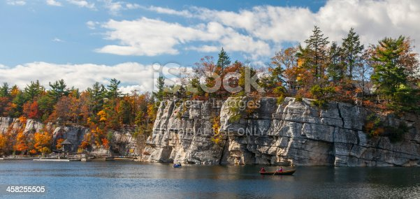 Mohonk Lake, NY, USA - October 22, 2012: Visitors enjoy a warm fall afternoon on Picturesque Mohonk Lake in the Hudson Valley in the Fall of 2012.