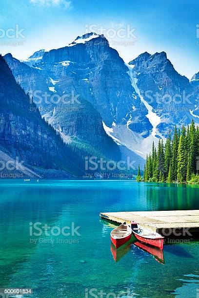 Lake moraine and canoe dock in banff national park picture id500601834?b=1&k=6&m=500601834&s=612x612&h=vmfxa7oxckxrula8v8veymsju30364piypiywcdov7u=