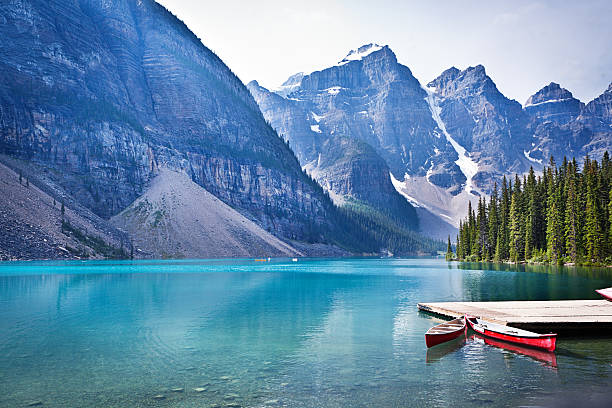 Lake Moraine and Canoe Dock in Banff National Park Lake Moraine in the Banff National Park of Canada, with its emerald water and mountain range of the Canadian Rockies. valley of the ten peaks stock pictures, royalty-free photos & images