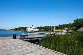 Gravenhurst, Ontarion, Canada - August 15, 2015: One pair of tourists are looking into the distance steamship at lake  Muskoka.