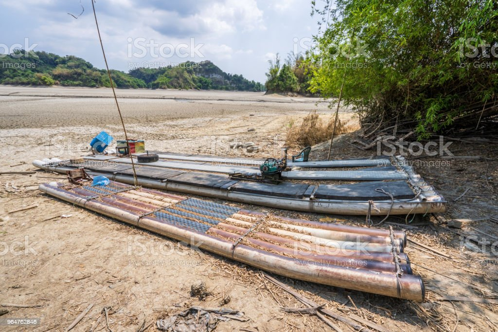 Lake of Dreams, a small but beautiful fishing port located in Wushantou Reservoir, Guantian, Tainan, Taiwan is drying up with cracks and bamboo boats are left aside. royalty-free stock photo