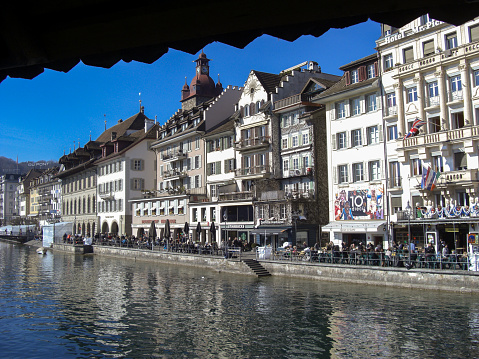 Lucerne, Switzerland, February 27, 2019 Water promenade in the city on a wonderful blue sky day