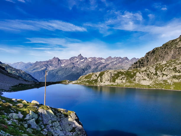 Lake of the sagne and behind the majestic Belledonne and its Grand pic. stock photo
