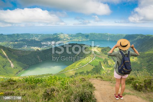 Young Girl Looking At Volcano Crater