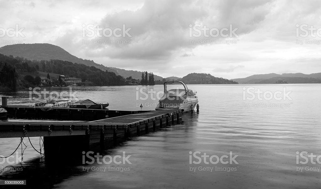 Lake Orta, boats moorage in wintertime. BW image stock photo