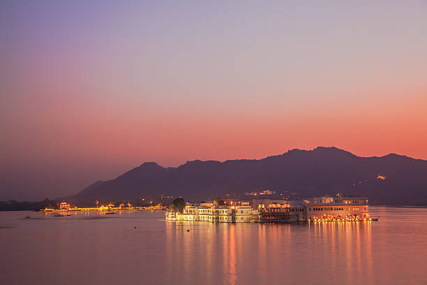 Lake Palace at night The view of Lake Palace in Udaipur at night lake palace stock pictures, royalty-free photos & images