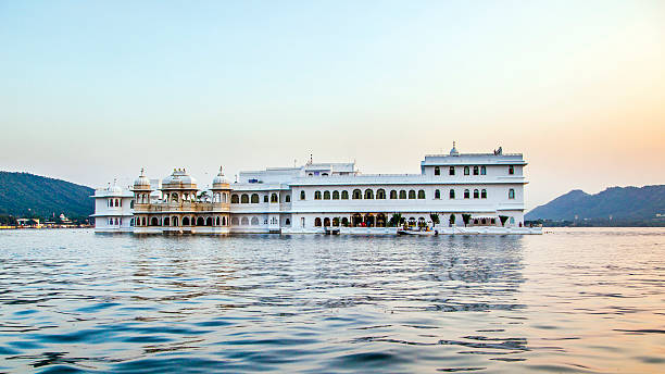 Lake Palace, Udaipur Rajasthan in early morning light The Lake Palace, Udaipur Rajasthan in early morning light lake palace stock pictures, royalty-free photos & images