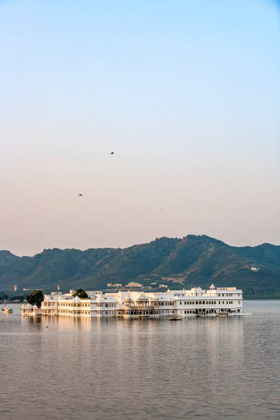 lake Palace, Udaipur Rajasthan in early morning light The Lake Palace, Udaipur Rajasthan in early morning light lake pichola stock pictures, royalty-free photos & images