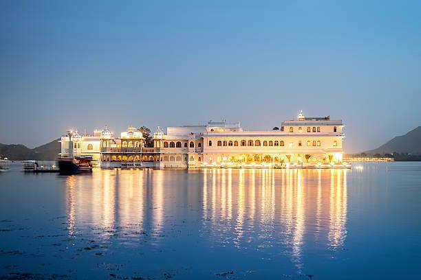 Lake Palace,Udaipur,India Illuminated Lake Palace at Night reflecting in the water. Udaipur, Rajasthan, India. udaipur stock pictures, royalty-free photos & images