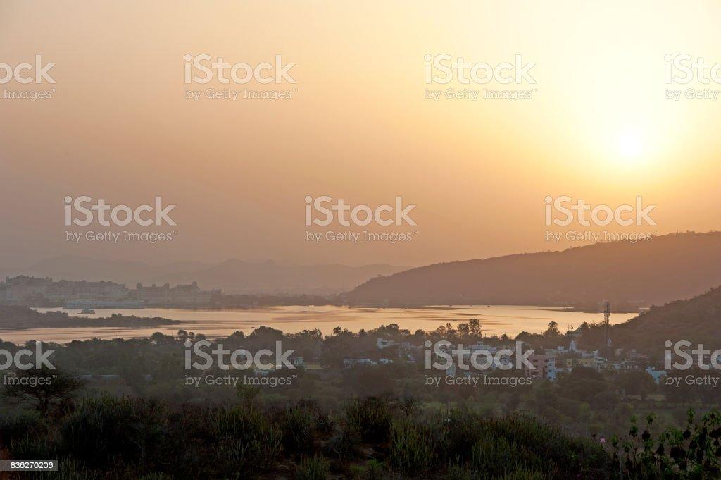 Lake Pichola at sunset, Udaipur, Rajasthan, Northern India stock photo