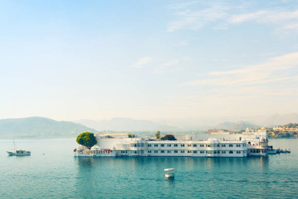 Lake Pichola in Udaipur Lake Palace (formerly known as Jag Niwas) on Lake Pichola. Udaipur, Rajasthan, India lake palace stock pictures, royalty-free photos & images