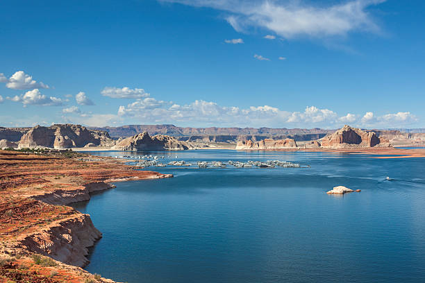 Lake Powell Summer photo of Lake Powell, a large reservoir on the border of Utah and Arizona. lake powell stock pictures, royalty-free photos & images