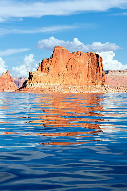 Lake Powell rock orange cliffs reflected in the smooth water of the lake Powell lake powell stock pictures, royalty-free photos & images