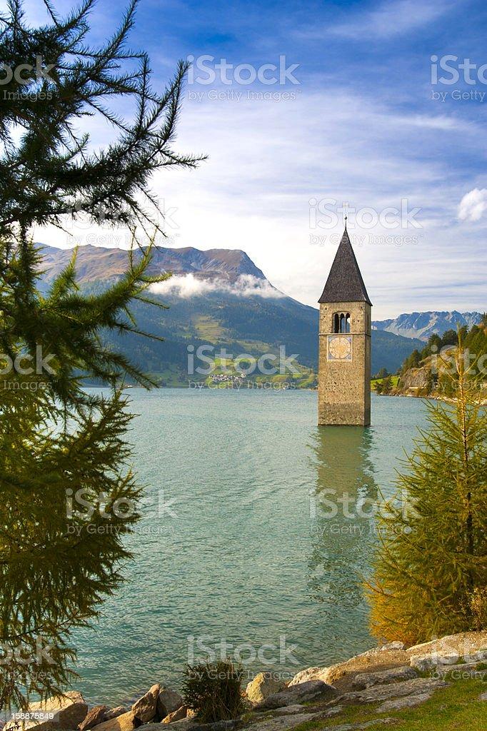 Lake Reschen with tower of the sunken church Altgraun royalty-free stock photo