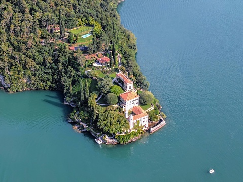Aerial view of Villa del Balbianello, built in 12th century and seen in movies like James Bond and Star Wars, overlooking Lake Como. Tremezzina, Italy. August 25, 2017.