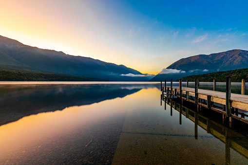 In this January 2021 long-exposure photo, Lake Rotoiti is viewed at dawn from its northern shore in Saint Arnaud, New Zealand. The lake is located within Nelson Lakes National Park.