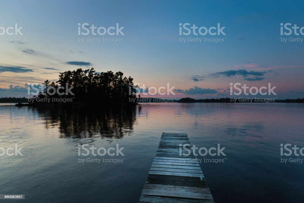 Lake Scene  and Boat Dock at Ely, Boundary Water Canoe Area, Minnesota, USA at Sunrise stock photo